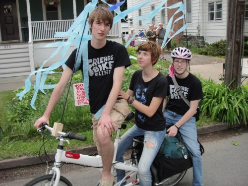 Three Millenials on a cargo bike.